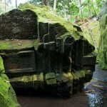 Ancient ruins of Buddhist structures lie in the river valley at Goa Gajah